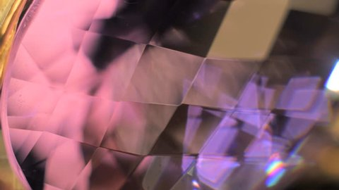 Fascinating rainbow colors due to light dispersion in crystal. Close up shot of beautiful, expensive and luxury jewel.