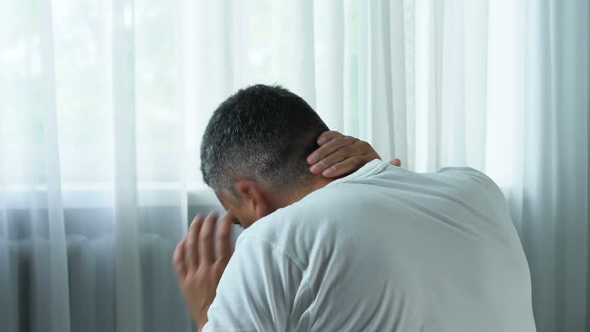 Adult man suffering sharp neck pain, massaging muscle spasm, health problem | Shutterstock HD Video #1013905421