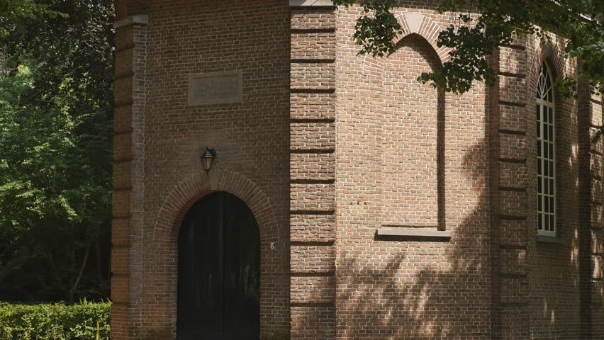 """Tilt down of the little Van Gogh church Nuenen. Painting: """"Congregation Leaving the Reformed Church in Nuenen"""" which was stolen in 2002 and recovered in 2016."""
