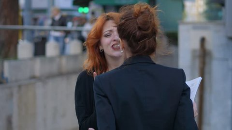 Quarrel Between two young business women in the street.Conflict,competition