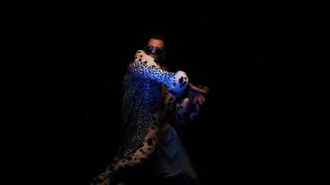 Glamorous guy dancing