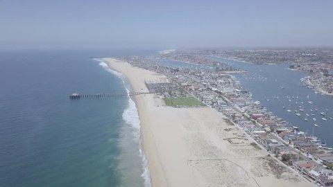 4K Newport Beach, Orange County - Flying Towards Balboa Pier And Newport Skyline  K Beautiful Newport Beach, Orange County in Southern California. This clip is is flying from the sea towards Newport