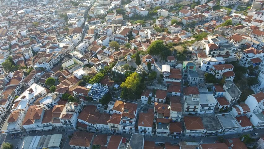 Aerial view of beautiful greek island and town, Skiathos. Drone view of Skiathos old town, Greece, during sunny summer day.