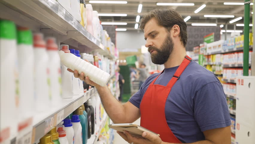 Store supervisor with tablet pc in hand checking the quality of the product in supermarke | Shutterstock HD Video #1013987471