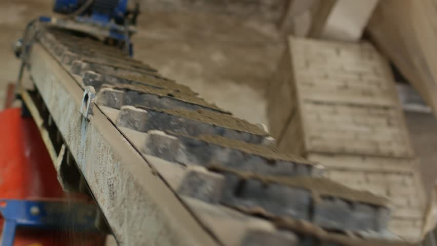 Manufacturing stage of interlocking concrete pavers for road surface