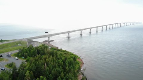 A beautiful aerial shot of the incredible confederation bridge that connects New Brunswick and Prince Edward Island with fog in the background