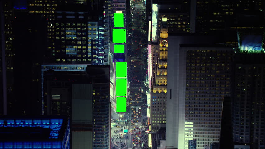 Aerial view of Times Square at night. Shot of New York City with green screens. Shot with a RED camera. 4k footage.
