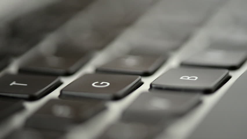Close-up of a young woman typing on a laptop keyboard close up | Shutterstock HD Video #1014130991