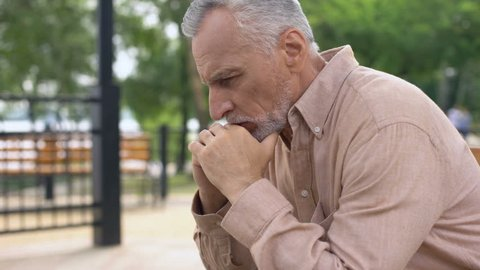 Desperate pensioner crying, depressed by sad memories, suffering loss, problem