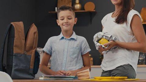 parents and schoolboy preparing to school