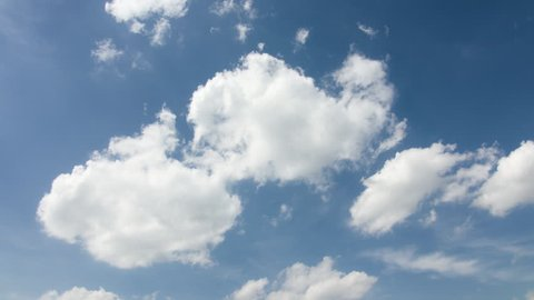 Blue sky background with white clouds. Long shot