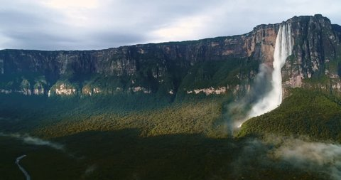 8th natural wonder of the world. Drone makes panning about the highest waterfall in the world, Angel Falls in the middle of the beautiful light of the jungle. Canaima National Park, Venezuela
