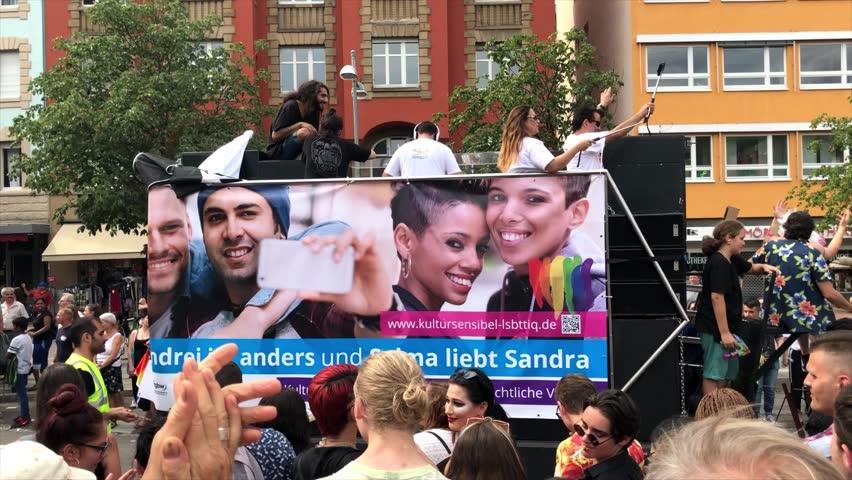 Stuttgart, Germany - July 28, 2018: Participants are celebrating Christopher Street Day, the gay lesbian pride festival in Stuttgart, Germany on the truck of the Turkish Community in Stuttgart.