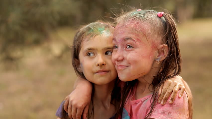 With children wash away the colored powder holi with water. Rest in a recreation park. Smiles, fun, joy of children | Shutterstock HD Video #1014356261