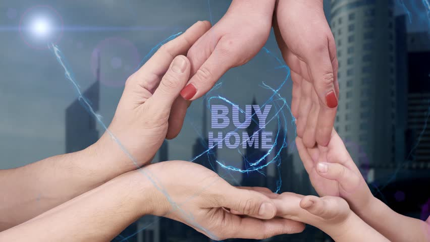 Men's, women's and children's hands show a hologram Buy home. The family holds a magical inscription on the background of a modern city