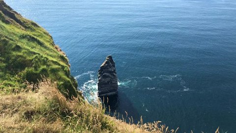 The famous Cliffs of Moher are sea cliffs located at the southwestern edge of the Burren region in County Clare, Ireland. They run for about 14 kilometres.