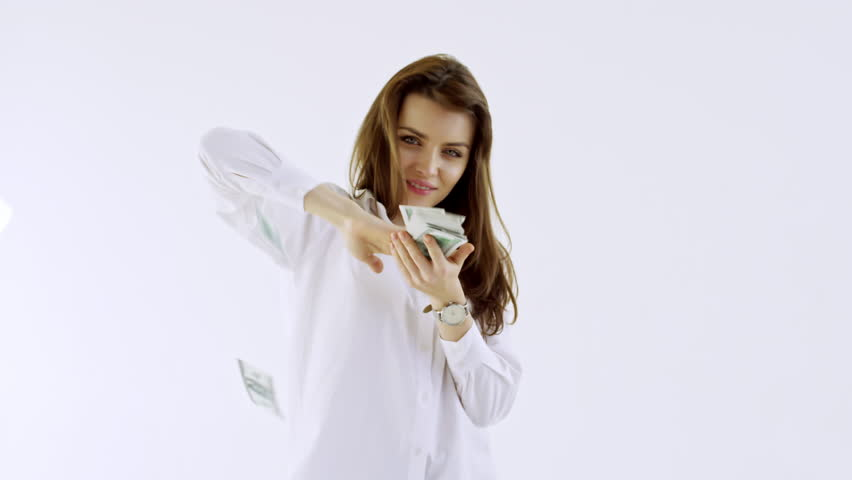 Studio shot with white background: confident young businesswoman smiling and making it rain money | Shutterstock HD Video #1014481331