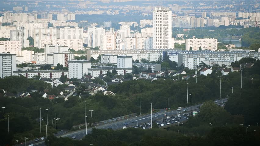 Heavy traffic jam over the A15 highway autoroute peripherique with the city of Sannois, Paris in the background - aerial still drone news report