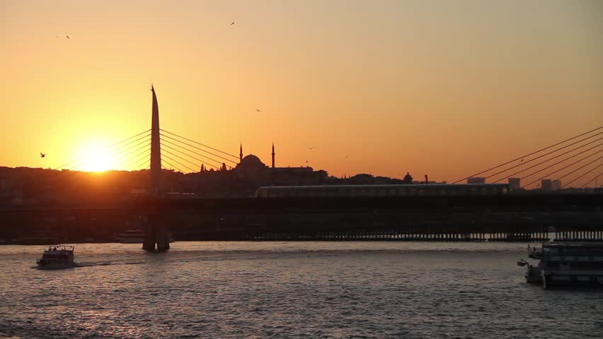 Orange sunset sky sunset and ferry traffic at sea in Eminonu, istanbul