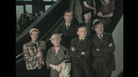 1930s: Family stands at bottom of steps, looks up. Older woman and younger woman talk.