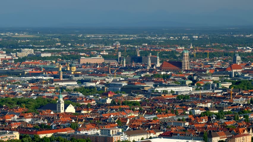 Aerial view of Munich from Olympiaturm (Olympic Tower). Munich, Bavaria, Germany. With camera panning #1014658751