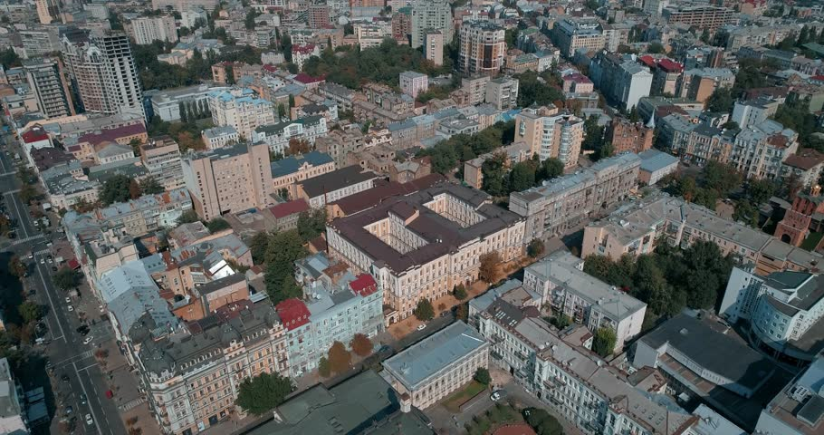 Aerial view of the roofs of buildings. Cars are driving along the road. Old-fashioned houses. Summer. Kiev (Kyiv). Ukraine. | Shutterstock HD Video #1014661211