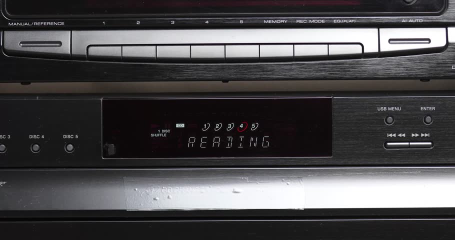 Close Up Of Digital Display On Retro Multi Disc CD Player And Equalizer