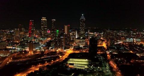 Atlanta Aerial v390 Flying low backwards away from downtown 1/18