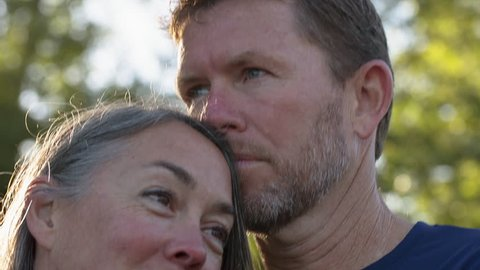 Close-up of affectionate couple looking away