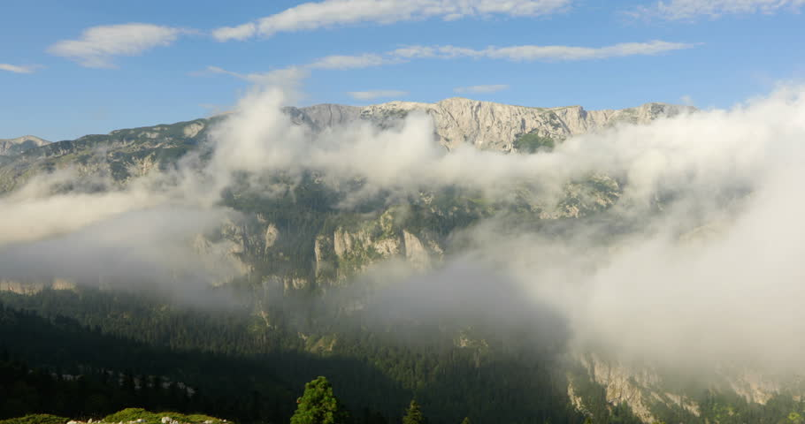 "Sunny day with clouds, shot from above, in high mountains, no people, Bosnia and Herzegovina, Republic of Srpska, National Park ""Sutjeska"" 