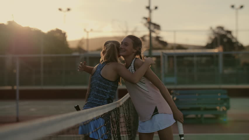 Young tennis players hug after their tournament, display of sportsmanship and friendship | Shutterstock HD Video #1014775391