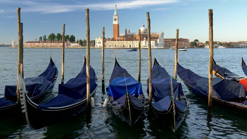 Venice, Italy.  Gondolas at Saint Mark (San Marco) square with San Giorgio di Maggiore church    Shutterstock HD Video #1014782921