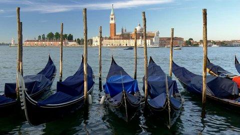 Venice, Italy.  Gondolas at Saint Mark (San Marco) square with San Giorgio di Maggiore church