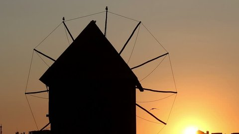 Old windmill silhouette sunset Nessebar Bulgaria