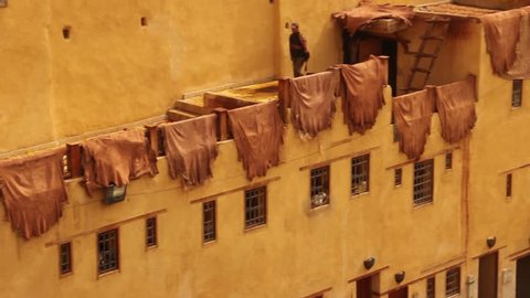 Man walking over the Dyes and Tannery of Fez, Morocco