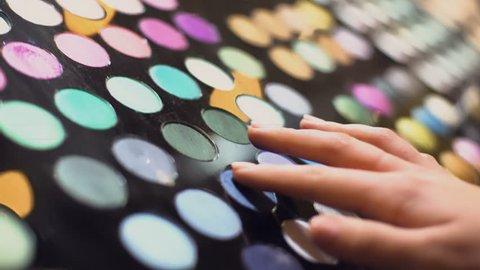 Shopping mall customer making eyeshadow swatches hand, beauty products, make-up
