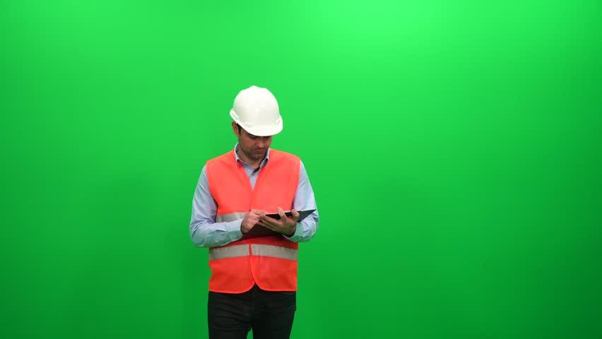 Engineer Preparing Report On A Green Screen | Shutterstock HD Video #1014876571