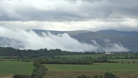 Weather front moving over Snowdonia and Menai Strait in high speed