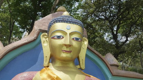 Buddha statue in the Swayambhunath temple. Monkey temple in Kathmandu, Nepal.
