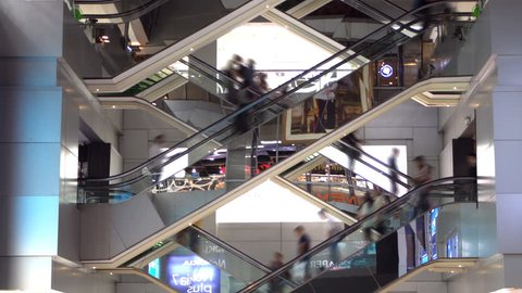 Time lapse of escalators in building.