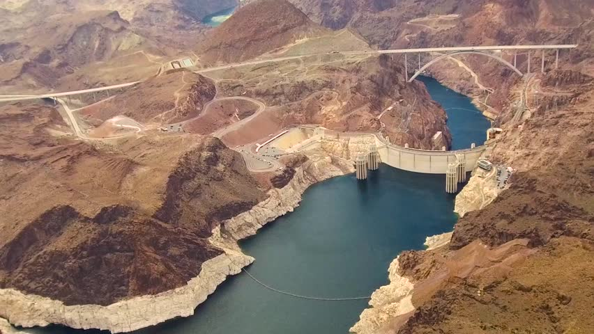 Landscape and infrastructure and concept - aerial view of hoover dam and mike callaghan - pat tillman memorial bridge over colorado river at grand canyon from helicopter