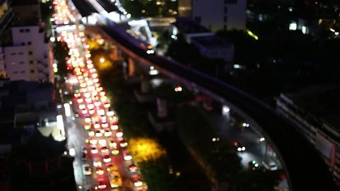 Electric trains in bangkok and Defocused night traffic lights, Expressway and Road traffic Transportation Systems In Thailand