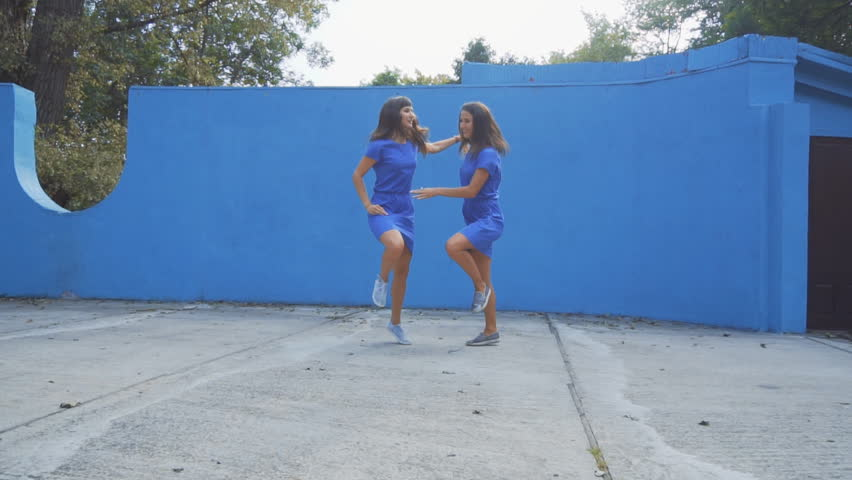 Twin Sisters Dancing on stage in the park