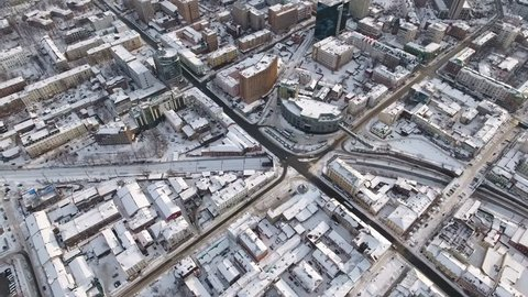 Helicopter Top Street historic old town Train TRANS-Siberian railway. Roof snow busy traffic car transport logistics. Soviet architecture cityscape. Vladivostok Russia. Winter sunny day. Aerial 4k