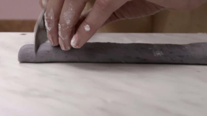 Chef's cutting gnocchi for italian pastas traditional dish