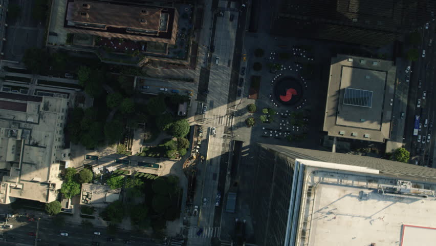 Top-down aerial view of an urban city during the day. Shot of buildings and skyscrapers in downtown Los Angeles. Shot with a RED camera. 4k footage.