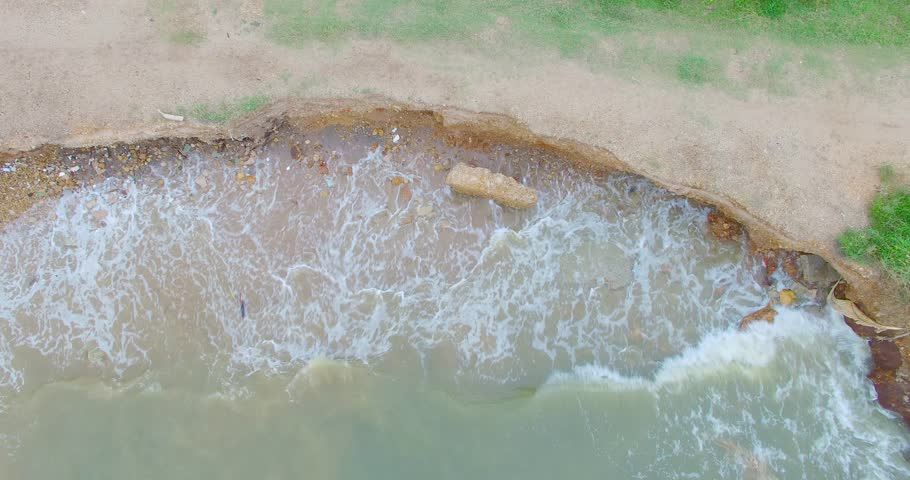 Aerial footage from Drone. Waves of sea erode the beach. Seashore were eroded by strongly wave.  footage 4K
