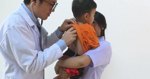 Male Doctor Examining Little Boy