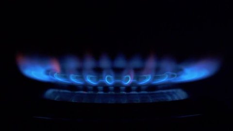 Gas stove ignites on a black background
