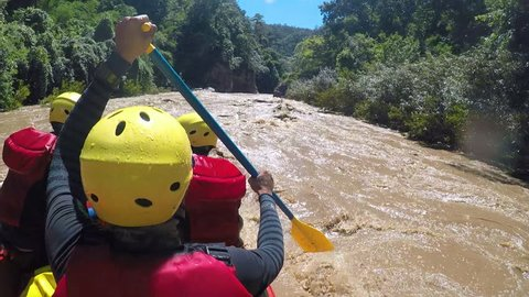 Group of adult men's screaming and yelling while whitewater rafting, boater creek ,kayaking in Pai river, Mae hong son province, Thailand.